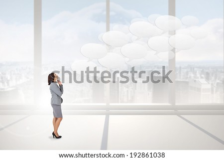 Focused businesswoman against bright white room with windows