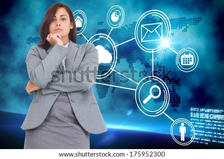 Focused businesswoman against futuristic technology interface - stock photo