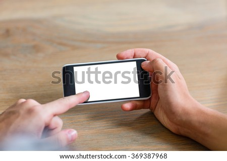 Focused couple using smartphone at home - stock photo