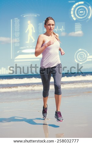 Focused fit blonde jogging on the beach against fitness interface