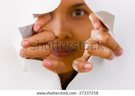 Focused mainly on the fingers trying break the thin wall. - stock photo