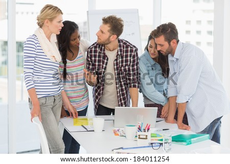 Focused team of designers having a meeting in creative office - stock photo