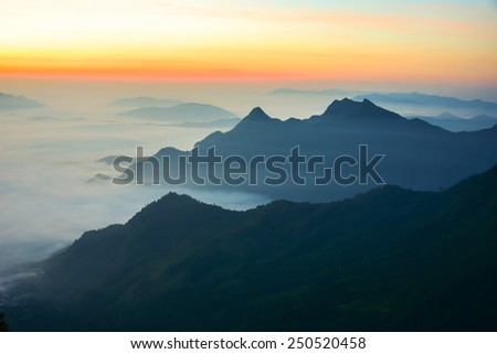 fog and cloud mountain valley sunrise landscape, Pu Chi Fa - Chiangrai Thailand - stock photo