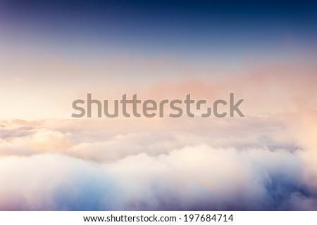 Fog and clouds on a blue sky. Beauty world. - stock photo
