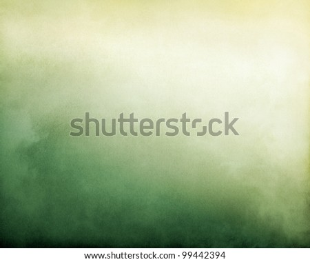 Fog and clouds on a green to yellow textured gradient background.  Image displays a pleasing paper grain and texture at 100%. - stock photo