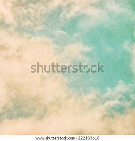 Fog and clouds on a grunge paper background.  Image displays significant grain and texture at 100 percent.