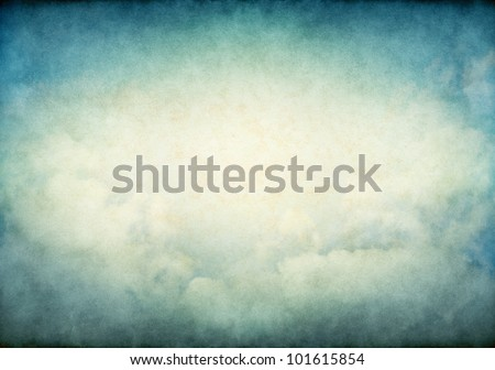 Fog and clouds with glowing yellow and green retro colors.  Image displays a pleasing paper grain and texture at 100%. - stock photo