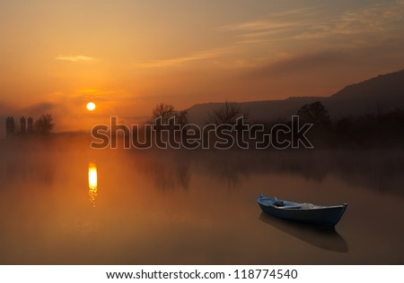 Fog and lake at sunrise - stock photo