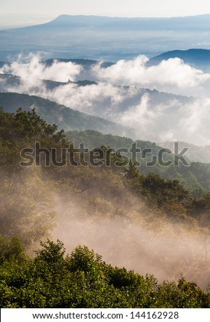 Fog and low clouds clear out of the Blue Ridge after a summer thunderstorm in Shenandoah National Park, Virginia. - stock photo