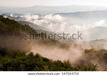 Fog and low clouds in the Blue Ridge Mountains, seen from Skyline Drive in Shenandoah National Park, Virginia - stock photo