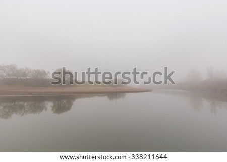 Fog and mist on a wild river - stock photo