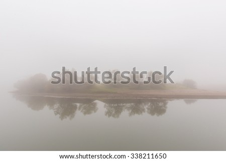Fog and mist on a wild river