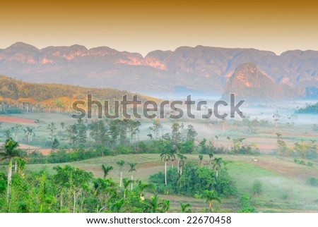 Fog at dawn in the Valley of Vinales in Pinar del Rio, famous for tobacco plantations in Cuba, world heritage site of Unesco - stock photo