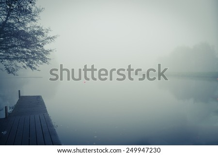fog at the river - stock photo