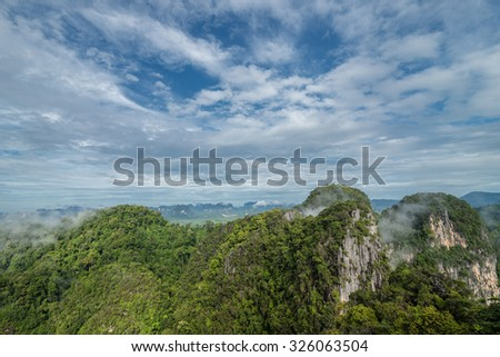 Fog cover mountain in morning at krabi Thailand