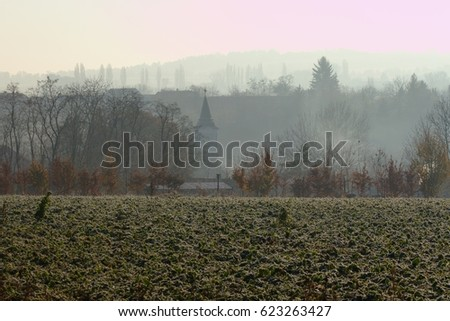 fog covered central european village in late autumn early winter