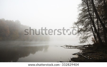Fog in morning on the lake - stock photo
