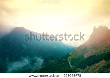 Fog in mountains. Fantasy and colorfull nature landscape. Nature conceptual image. - stock photo