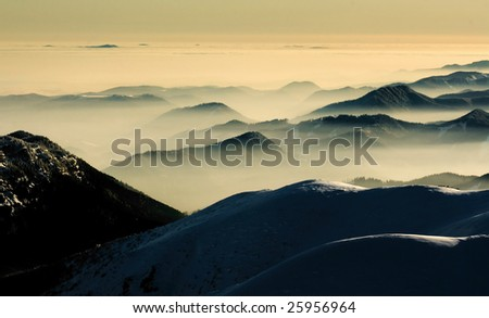 Fog in the mountains - stock photo