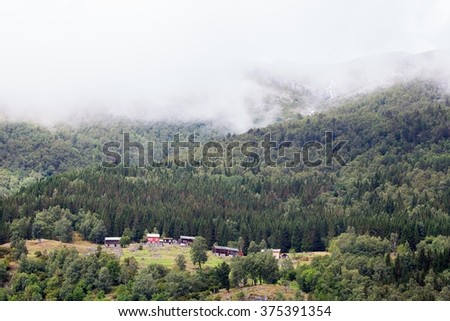 Fog in the mountains (fjord Norway) - stock photo