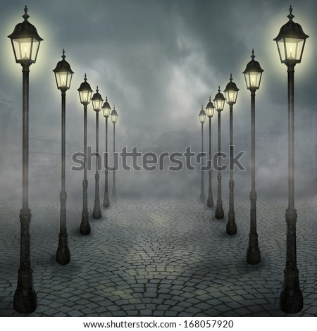 Fog in the park with street lamps - stock photo