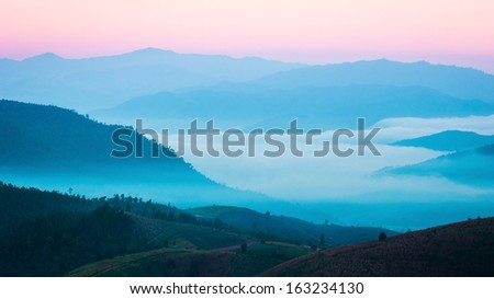 Fog on the mountain at Mae Cham, Chiangmai Province, Northern Thailand  - stock photo