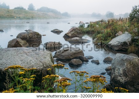fog on the river - stock photo