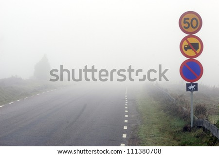 Fog over a country road, Sweden