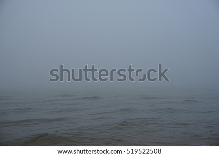 Fog over big lake on cold November morning