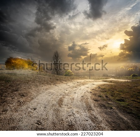 Fog over country road in the autumn - stock photo