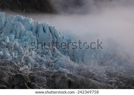 Fog over the Fox Glacier, New Zealand - stock photo