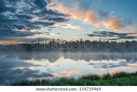 fog over the river - stock photo