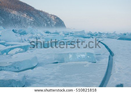 Fog rocks and field of ice siberian Baikal Lake in winter