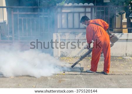 Fogging DDT spray kill mosquito for control Malaria, Encephalitis, Dengue and Zika in village at Bangkok Thailand. - stock photo