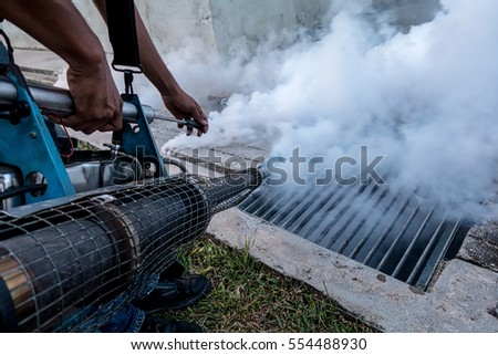 Fogging into the drain to prevent spread of dengue fever