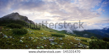 foggy and cloudy mountains panorama - stock photo