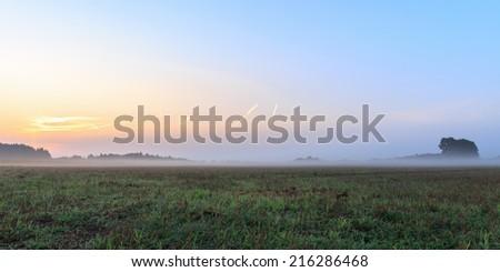 Foggy Bavarian Sunrise. Lovely Mist in the rural countryside of Upper Franconia - stock photo