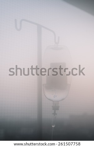Foggy blurred of iv bag with vintage effect - stock photo