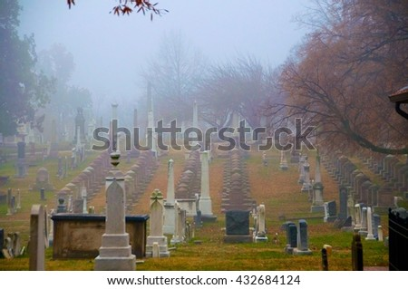 Foggy cemetery - stock photo