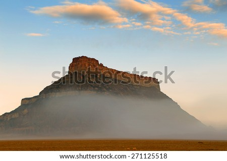 Foggy dawn at Factory Butte, Utah, USA. - stock photo