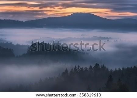 foggy dawn over the Bohemian Switzerland - stock photo