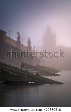 Foggy day near Charles bridge with reflection at Vltava river, Prague, Czech republic - stock photo