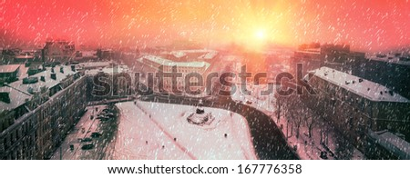 Foggy evening view from the bell tower of St. Sophia Orthodox monastery opens a panorama , the paths of which are single figures of passers-people, Beautiful sunrise over St. Michael's Monastery  - stock photo