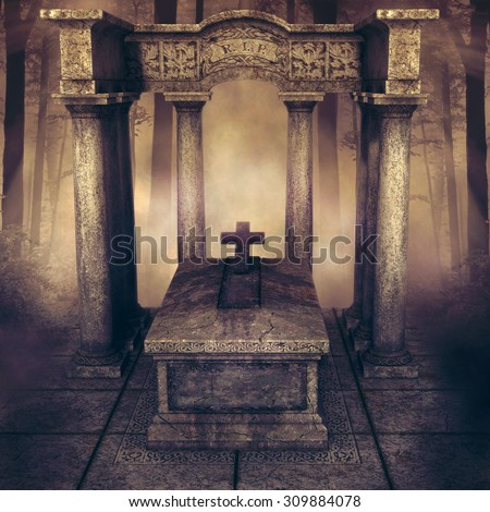 Foggy forest with an old grave with columns and a cross - stock photo