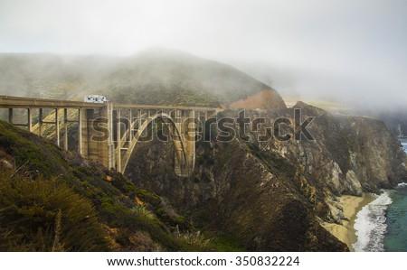 foggy highway 1 Big Sur bridge California coast - stock photo