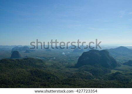 foggy landscape from the summit of ngorn nak mountain at krabi, thailand on a vague morning with soft layer of limestone mountains - stock photo