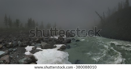 Foggy landscape with mountain river - stock photo