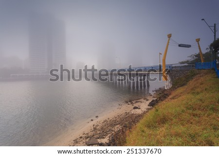 Foggy morning in the centre of big modern Australian city (Gold Coast, Surfers Paradise, QLD, Australia) - stock photo