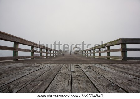 Foggy morning pier in St Augustine, Florida - stock photo