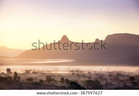 Foggy mountain valley at sunrise in the village in Nasik, Maharashtra, India